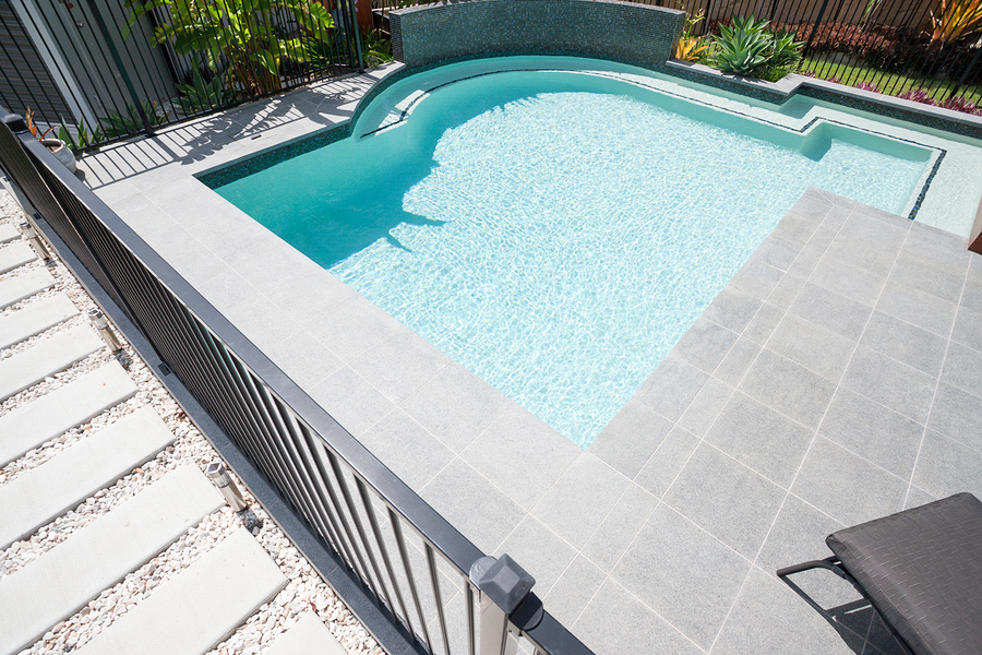 modern pool with gravel pathway